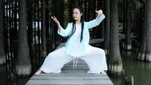 woman practice taichi in the bamboo forest